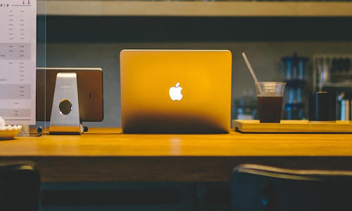 The back of an iMac on a desk.